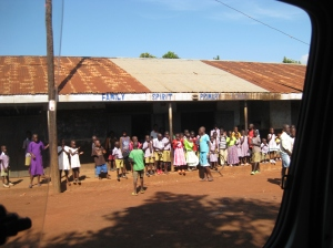 The children waiting outside as our vans pulled up to the orphanage.